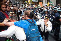 "Protesters with the ""Occupy Wall Street"" movement gather by the thousands in the early morning of October 14, 2011 at Zuccotti Park in New York City.  Brookfield Properties, owners of the private park, had requested the NYPD's assistance in evacuating the park to facilitate a routine cleaning.  With protesters gathered en masse and a confrontation likely, Brookfield rescinded their request at the last minute.  Feeling victorious and emboldened, hundreds of protesters then proceeded to march along the streets of Wall Street and promptly found the confrontation that had been avoided by the Brookfield capitulation."