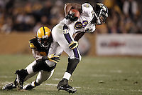 PITTSBURGH, PA - NOVEMBER 06:  Torrey Smith #82 of the Baltimore Ravens attempts to evade a tackle by William Gay #22 of the Pittsburgh Steelers after catching a pass during the game on November 6, 2011 at Heinz Field in Pittsburgh, Pennsylvania.  (Photo by Jared Wickerham/Getty Images)