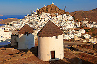 The Windmills overlooking  Chora town. Ios Cylcades Islands, Greece.