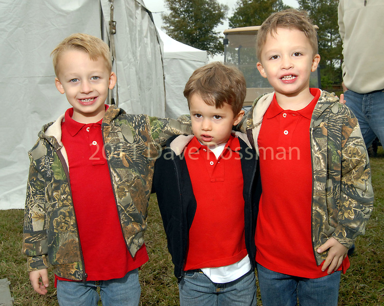 From left: Gage,4, Colton,3, and Gunner Greene,4, at the Lanier Law Firm's Holiday Bash Sunday Dec. 13,2009.(Dave Rossman/For the Chronicle)