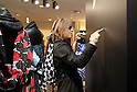 "December 24, 2016, Tokyo, Japan - Yoshiki, a member of Japanese rock group ""X Japan"" puts his autograph on the wall as he attends an opening event to promote his designed kimono dress ""Yoshikimono"" at the Isetan department store in Tokyo on Monday, December 26, 2016. Business of Yoshiki's parents was kimono fabrics shop, but he did not take over his family business.  (Photo by Yoshio Tsunoda/AFLO) LWX -ytd-"