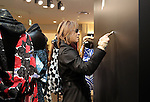 """December 24, 2016, Tokyo, Japan - Yoshiki, a member of Japanese rock group """"X Japan"""" puts his autograph on the wall as he attends an opening event to promote his designed kimono dress """"Yoshikimono"""" at the Isetan department store in Tokyo on Monday, December 26, 2016. Business of Yoshiki's parents was kimono fabrics shop, but he did not take over his family business.  (Photo by Yoshio Tsunoda/AFLO) LWX -ytd-"""
