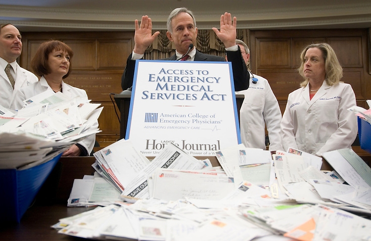 "Flanked by emergency room physicians, House Science and Technology Chairman Bart Gordon, D-Tenn., speaks at a news conference to re-introduce the Access to Emergency Medical Services Act of 2007 on Wednesday, Feb. 7, 2007. Thousands of petitions frmo people across the country, generated by articles in ""Ladies' Home Journal"" were delivered to Congress in support of the legislation. Rep. Pete Sessions, R-Texas, also spoke at the event."