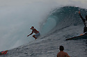 Kelly Slater (USA) last wave drinking beer as he come out of the tube, winning the final of the Billabong Tahiti Pro in Teahupoo in Tahiti.