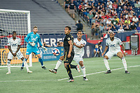 FOXBOROUGH, MA - AUGUST 4: Eddie Segura #4 of Los Angeles FC prepares to pass the a corner kick back during a game between Los Angeles FC and New England Revolution at Gillette Stadium on August 3, 2019 in Foxborough, Massachusetts.