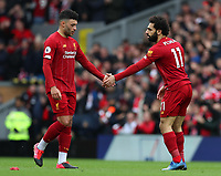7th March 2020; Anfield, Liverpool, Merseyside, England; English Premier League Football, Liverpool versus AFC Bournemouth; Alex Oxlade-Chamberlain of Liverpool shakes hands with team mate Mohammed Salah