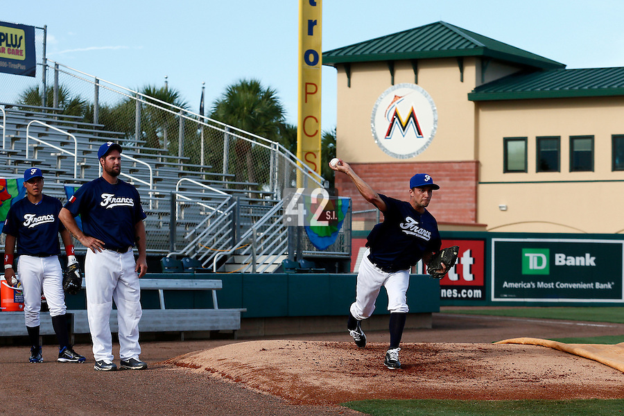 20 September 2012: Quentin Pourcel is seen in the bullpen, while Eric Gagne and Boris Marche watch prior to Spain 8-0 win over France, at the 2012 World Baseball Classic Qualifier round, in Jupiter, Florida, USA.
