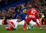 Willian of Chelsea tackled by Filipe Luis ion Atletico Madrid during the Champions League Group C match at the Stamford Bridge, London. Picture date: December 5th 2017. Picture credit should read: David Klein/Sportimage