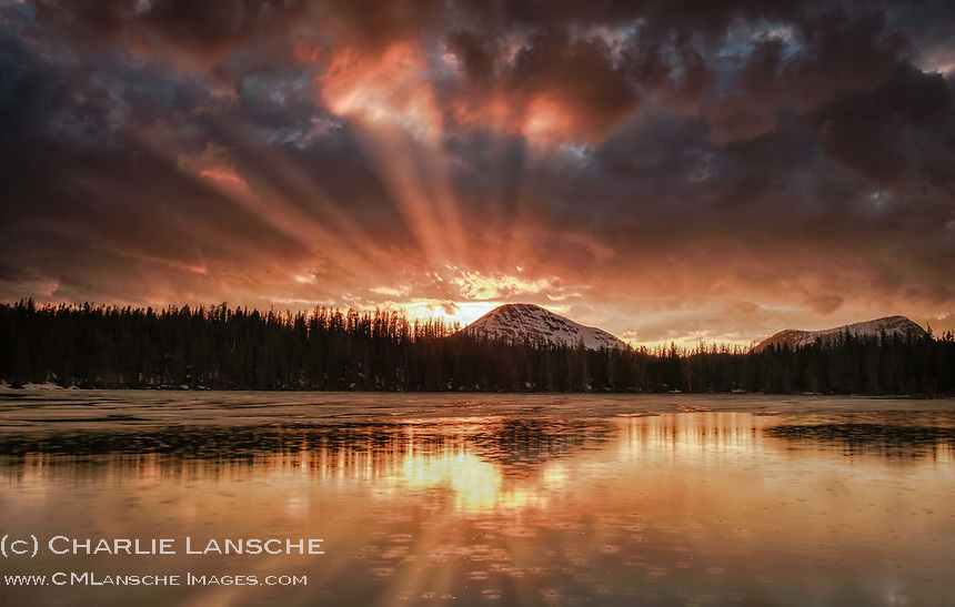 Higher Power. Crepuscular rays, rain drops on the water, and a fiery sky - one of those moments that forces contemplation of a higher power. Perhaps this is why I venture into the mountains, for this is my church. Uinta Mountains, Utah. June