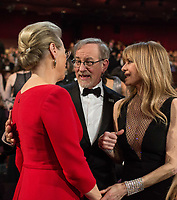 Oscar&reg;-nominee Meryl Streep, Oscar-nominee Steven Spielberg, and Kate Capshaw greet each other during the live ABC Telecast of the 90th Oscars&reg; at the Dolby&reg; Theatre in Hollywood, CA on Sunday, March 4, 2018.<br /> *Editorial Use Only*<br /> CAP/PLF/AMPAS<br /> Supplied by Capital Pictures