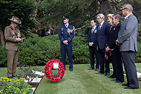 The Australian Ambassador to Japan, Richard Court and relatives of Victoria Cross recipient, Ray Simpson. lay a wreath of poppies at his grave  during the Remembrance Sunday ceremony at the Hodogaya, Commonwealth War Graves Cemetery in Hodogaya, Yokohama, Kanagawa, Japan. Sunday November 11th 2018. The Hodagaya Cemetery holds the remains of more than 1500 servicemen and women, from the Commonwealth but also from Holland and the United States, who died as prisoners of war or during the Allied occupation of Japan. Each year officials from the British and Commonwealth embassies, the British Legion and the British Chamber of Commerce honour the dead at a ceremony in this beautiful cemetery. The year 2018 marks the centenary of the end of the First World War in 1918.