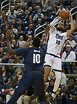 Nevada'sCaleb Martin (10) takes a jump shot over Akron's Deng Riak (10) in the first half of an NCAA college basketball game in Reno, Nev., Saturday, Dec. 22, 2018. (AP Photo/Tom R. Smedes)