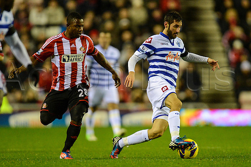 27.11.2012 Sunderland, England. QPR's Esteban Granero is chased down by Stephane Sessegnon during the Premier League game between Sunderland and Queens Park Rangers at the Stadium of Light.