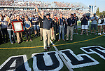 Former Nevada Head Coach Chris Ault was honored before the start of a college football game between UC Davis and Nevada in Reno, Nev., on Saturday, Sept. 7, 2013. The ceremony unveiled the naming of the field after Ault, the winningest coach in school history. (AP Photo/Cathleen Allison)