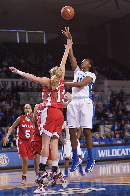 Marist junior forward Emma O'Connor (left) attempting to block UK junior center DeNesha Stallworth (right) shooting for two during the first half of the UK vs. Marist basketball game at Memorial Coliseum on Sunday, Dec. 30, 2012. Photo by Adam Chaffins | Staff