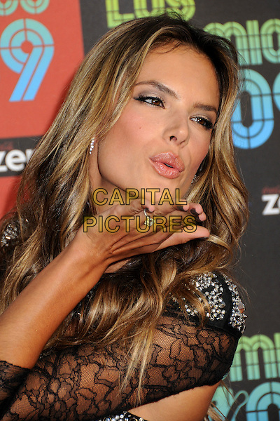 ALESSANDRA AMBROSIO .MTV Los Premios Awards 2009 held at the Gibson Amphitheatre, Universal City, California, USA, 15th October 2009..portrait headshot smiling black lace silver beaded cut out jewel encrusted embellished sparkly hand blowing kiss gesture pouting lips .CAP/ADM/BP.©Byron Purvis/Admedia/Capital Pictures