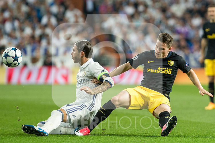 Sergio Ramos of Real Madrid competes for the ball with Kevin Gameiro of Atletico de Madrid  during the match of Champions League between Real Madrid and Atletico de Madrid at Santiago Bernabeu Stadium  in Madrid, Spain. May 02, 2017. (ALTERPHOTOS/Rodrigo Jimenez)