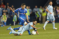Claudio Bieler (16) forward Sporting KC fouled by Davy Arnaud..Sporting Kansas City defeated Montreal Impact 2-0 at Sporting Park, Kansas City, Kansas.