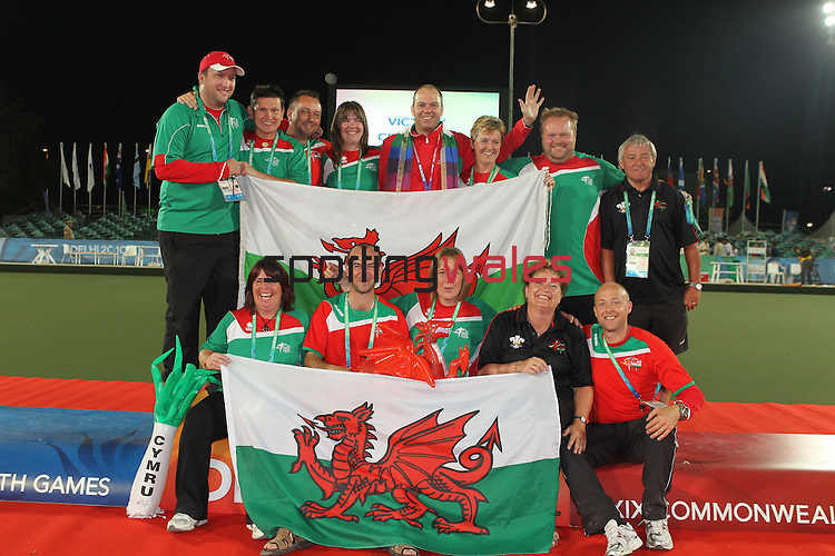 Delhi 2010 Commonwealth Games..Rob Weale (Wales) celebrates with the Team Wales bowls squad after beating Australian Leif Selby to win the Gold medal in the final of the Mens singles .13.10.10.Photo Credit-Steve Pope-Sportingwales