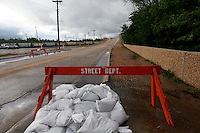 Sandbags piled up in front of the State Highway WW bridge in Poplar Bluff, MO on Wednesday, April 27, 2011. By Wednesday night, official water levels in Poplar Bluff had reached to 19.54 feet.