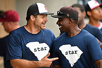 Ryan Klesko, left, and Orlando Hudson talk in the dugout during the Celebrities vs. Soldiers Softball Game as part of the All-Star Game festivities on Monday, June 19, 2017, at Spirit Communications Park in Columbia, South Carolina. (Tom Priddy/Four Seam Images)