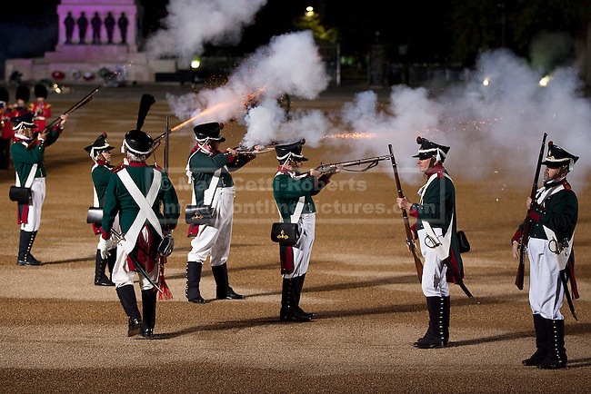 13/06/2012. LONDON, UK. As fireworks detonate in the background re-enactors of the 'Moscow Militia' fire their muskets during a performance of Tchaikowsky's '1812 Overture' at the annual Beating Retreat parade at Horse Guards Parade in London. On two successive evenings each year in June a pageant of military music, precision drill and colour takes place on Horse Guards Parade in the heart of London when the Massed Bands of the Household Division carry out the Ceremony of Beating Retreat. 300 musicians, drummers and pipers perform this age-old ceremony. The Retreat has origins in the early days of chivalry when beating or sounding retreat pulled a halt to the days fighting. Photo credit: Matt Cetti-Roberts