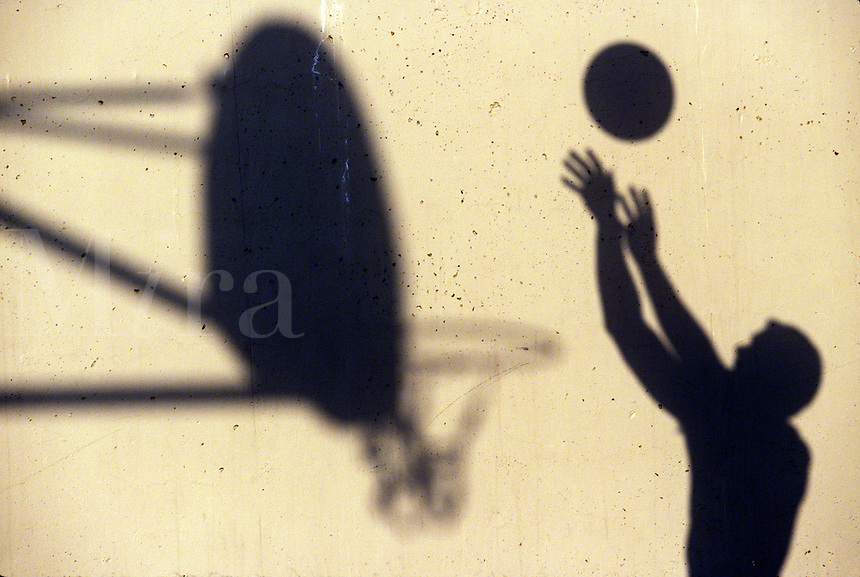 Shadow of a basketball player.