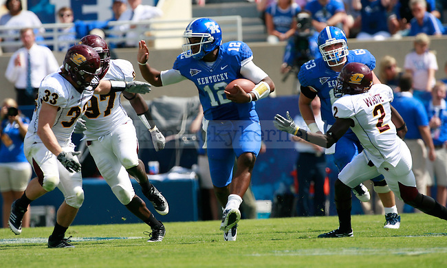 UK quarterback Morgan Newton goes for a stiff arm against Central Michigan linebacker Mike Petrucci during the second half of UK's first home game against Central Michigan, Saturday, Sept. 10, 2011 in Lexington, Ky.  Photo by Brandon Goodwin | Staff
