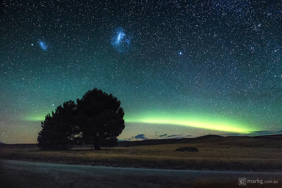 We had just finished the Dark Skies of Wonder Astrophotography workshop at Lake Tekapo recently, when all of the sudden this stunning arc of light formed low to the horizon to the south. It was the Aurora Australis making an appearance, but somewhat unique, as the arc formation wasn&rsquo;t really seen that much in the southern hemisphere. I knew I had to get a photo of it, so jumped in my car to head to a location near Lake Alexandrina where we had been shooting earlier in the night.<br /> <br /> The location was perfect for the photo I had in mind. The Aurora was arcing behind the big old tree there, and the Magellanic Clouds were also stunning in the night sky. I composed the scene in front of me, and took the shot - this was certainly one night of astrophotography to remember...