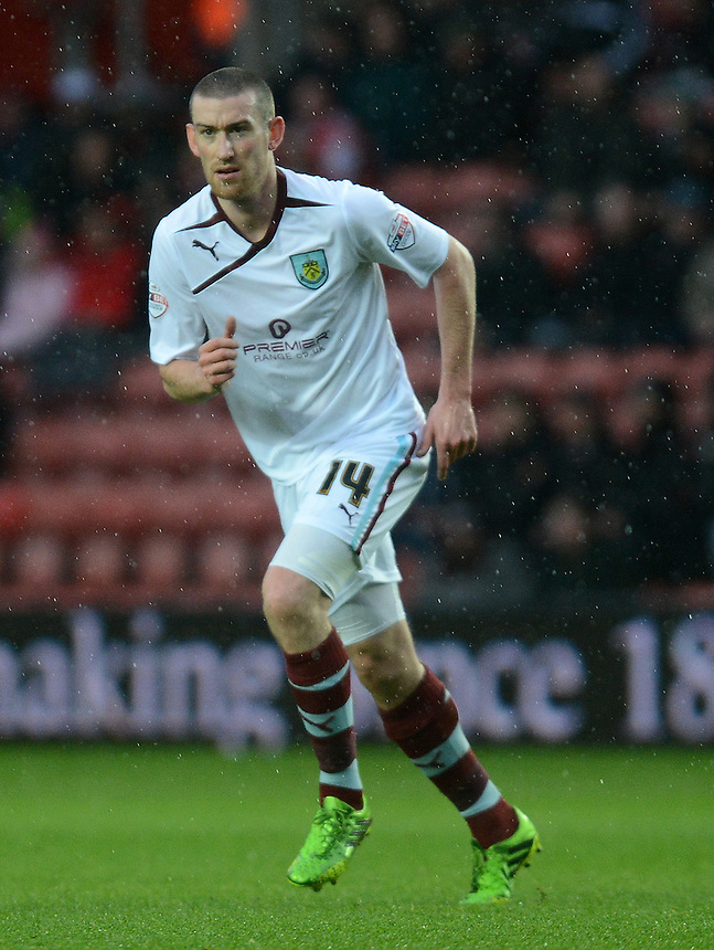 Burnley's David Jones in action during todays match  <br /> <br /> Photo by Ian Cook/CameraSport<br /> <br /> Football - FA Challenge Cup Third Round - Southampton v Burnley - Saturday 4th January 2014 - St Mary's Stadium - Southampton<br /> <br />  &copy; CameraSport - 43 Linden Ave. Countesthorpe. Leicester. England. LE8 5PG - Tel: +44 (0) 116 277 4147 - admin@camerasport.com - www.camerasport.com