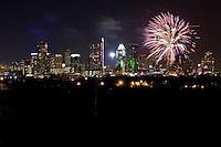 Fireworks shooting over downtown Austin, Texas High Rise Buildings.
