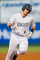 Josh Phegley (4) of the Charlotte Knights rounds the bases after hitting a home run against the Syracuse Chiefs at Knights Stadium on August 29, 2012 in Fort Mill, South Carolina.  (Brian Westerholt/Four Seam Images)