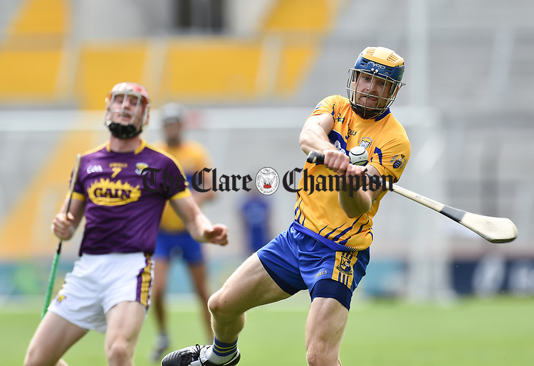 Seadna Morey of Clare in action against Diarmuid O Keeffe of Wexford during their All-Ireland quarter final at Pairc Ui Chaoimh. Photograph by John Kelly.