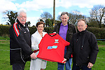 Ann Reid Flo Gas presenting a new kit to Rossin rovers, Brendan Reid, Alan McAleer and Frank Taaffe.<br /> Picture: www.newsfile.ie