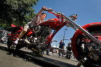 A young boy rides on a motorcycle chopper at Food Lion Speed Street in uptown Charlotte, NC.