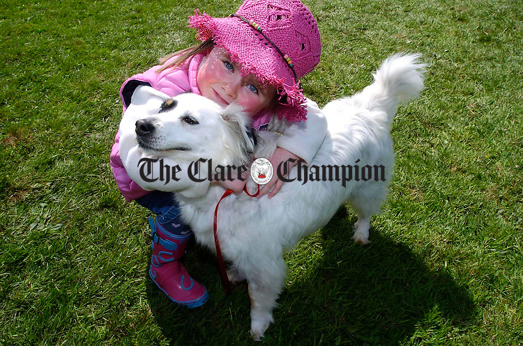 Local girl Abigail Conroy with her dog at Newmarket on Fergus Show. Photograph by John Kelly.