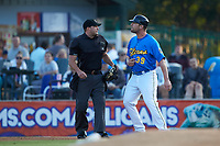 Home plate umpire Jake Bruner tries to keep Myrtle Beach Pelicans manager Steve Lerud (39) away from base umpire Mark Bass (not pictured| during the game against the Winston-Salem Dash at TicketReturn.com Field on May 16, 2019 in Myrtle Beach, South Carolina. The Dash defeated the Pelicans 6-0. (Brian Westerholt/Four Seam Images)