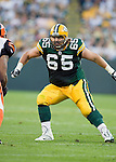Offensive lineman Mark Tauscher #65 of the Green Bay Packers prepares to block against the Cincinnati Bengals at Lambeau Field on August 11, 2008 in Green Bay, Wisconsin. The Bengals beat the Packers 20-17. (AP Photo/David Stluka)