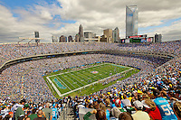 Interior photography of the Bank of America Stadium (Carolina Panthers Stadium) during a game in September 2011. Photo shows the stands filled with fans, players on the field and the Charlotte NC city skyline in the background. Duke Energy tower is completed in this photo (no cranes on the Duke Energy headquarters building). Photo taken as the Carolina Panthers vs. The Green Bay Packers at Bank of America Stadium in Charlotte, North Carolina...Photos by: Patrick Schneider Photo.com