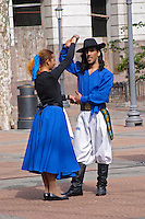 Plaza de Cagancha Square, a couple man and woman dancing flamenco and tango on a city square, dressed in blue skirt black top, white pants, blue shirt and black hat Montevideo, Uruguay, South America