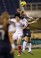 BOCA RATON, FL - DECEMBER 15, 2012: Becky Sauerbrunn (4) of the USA WNT goes for a header with Zhang Rui (25) of China WNT during an international friendly match at FAU Stadium, in Boca Raton, Florida, on Saturday, December 15, 2012. USA won 4-1.