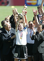 Bettina Wiegmann (Germany) holds a World Cup trophy, Germany vs. Sweden in Carson, California on October 12th, 2003.  Germany won 2-1 against Sweden in overtime.