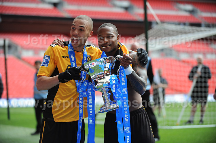 Newport players Christian Jolley and Aaron O'Connor celebrate with the cup after winner promotion during the Newport County v Wrexham Blue Sq. Bet Premier league playoff final at Wembley Stadium, London, England Sunday 5th May 2013. Credit for pictures to Jeff Thomas Photography - www.jaypics.photoshelter.com - 07837 386244 - Use of images are restricted without prior permission of the copyright owner Jeff Thomas Photography.