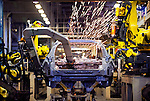 Robots get to work on the body of a new Nissan Motor Co. vehicle at the automaker's assembly plant in Tochigi, Japan on Thursday 12 Nov.  2009.