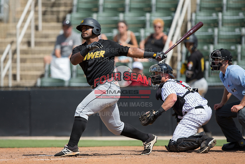 Alexis Bastardo (24) of the West Virginia Power follows through on his swing against the Kannapolis Intimidators at Kannapolis Intimidators Stadium on June 18, 2017 in Kannapolis, North Carolina.  The Intimidators defeated the Power 5-3 to win the South Atlantic League Northern Division first half title.  It is the first trip to the playoffs for the Intimidators since 2009.  (Brian Westerholt/Four Seam Images)