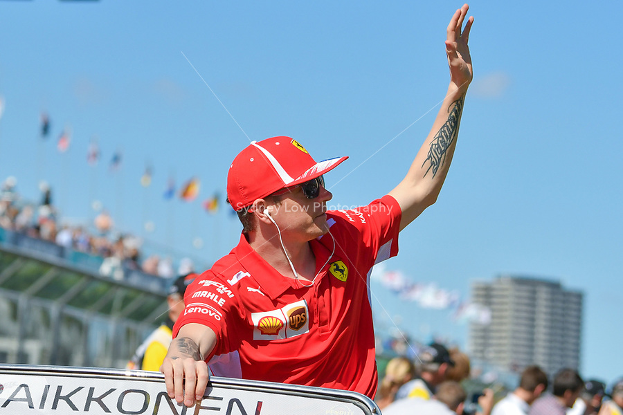 March 25, 2018: Kimi Raikkonen (FIN) #7 from the Scuderia Ferrari team waves to the crowd during the drivers' parade at the 2018 Australian Formula One Grand Prix at Albert Park, Melbourne, Australia. Photo Sydney Low