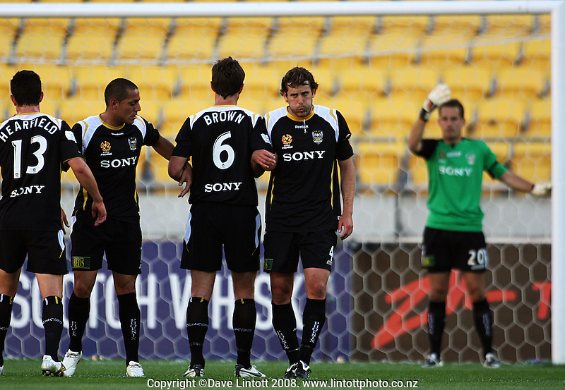 Phoenix' Troy Hearfield, Leo Bertos, Tim Brown and Jon McKain form a wall for a Perth free kick as keeper Glen Moss directs them during the A-League football match between the Wellington Phoenix and Perth Glory at Westpac Stadium, Wellington, New Zealand on Saturday, 13 December 2008. Photo: Dave Lintott / lintottphoto.co.nz