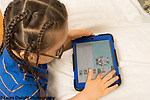 2 year old toddler boy playing with iPad tablet