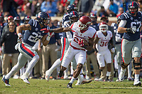 Hawgs Illustrated/BEN GOFF <br /> Josh Liddell (28), Arkansas free safety, evades Jordan Wilkins (22), Ole Miss running back, as he runs back an interception in the second quarter Saturday, Oct. 28, 2017, at Vaught-Hemingway Stadium in Oxford, Miss.