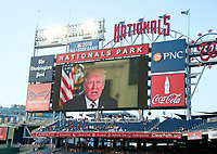 United States President Donald J. Trump delivers a message from the scoreboard prior to the 56th Annual Congressional Baseball Game for Charity where the Democrats play the Republicans in a friendly game of baseball at Nationals Park in Washington, DC on Thursday, June 15, 2017. Photo Credit: Ron Sachs/CNP/AdMedia